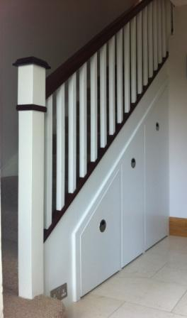 Traditional stairs UK in dark wood and white paint.