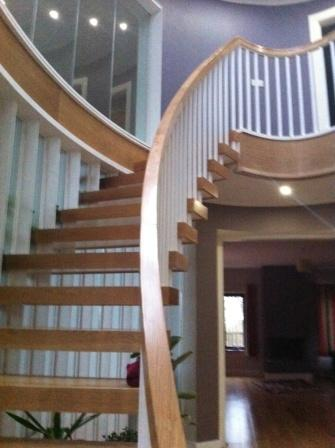 curved cantilever stairs in open rise stairs UK