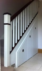 Traditional straight stairs with under stair storage